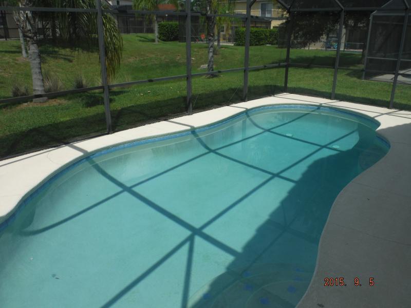 inground pool with screened enclosure
