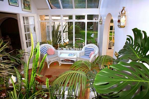 Bright open conservatory with sofas to relax