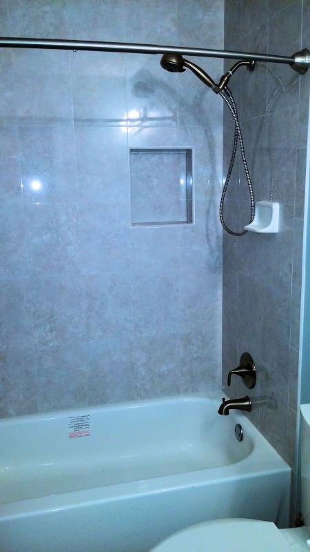 Three full completely remodeled bathrooms with imported Italian porcelain, granite topped vanities