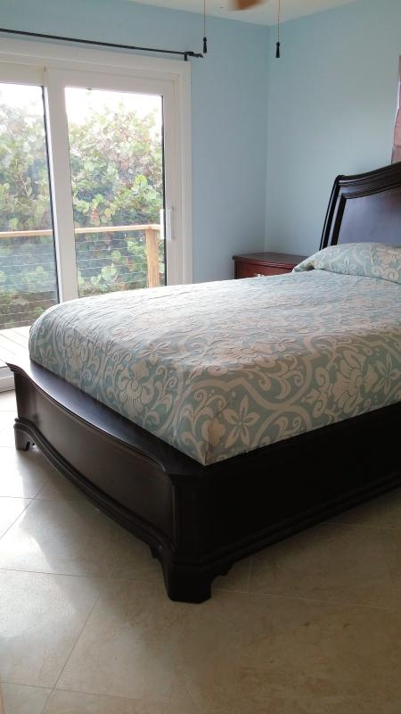 Master with brand new top-of-the-line bedding in room with adjoining sunset deck and master bath