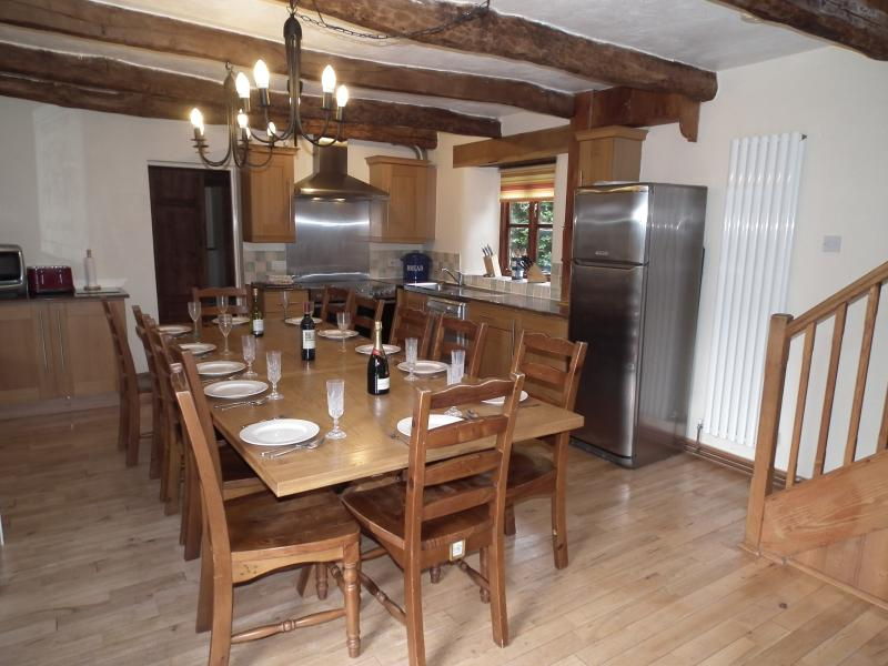Solid oak table in Gulliver kitchen / diner seats up to 20 when fully extended
