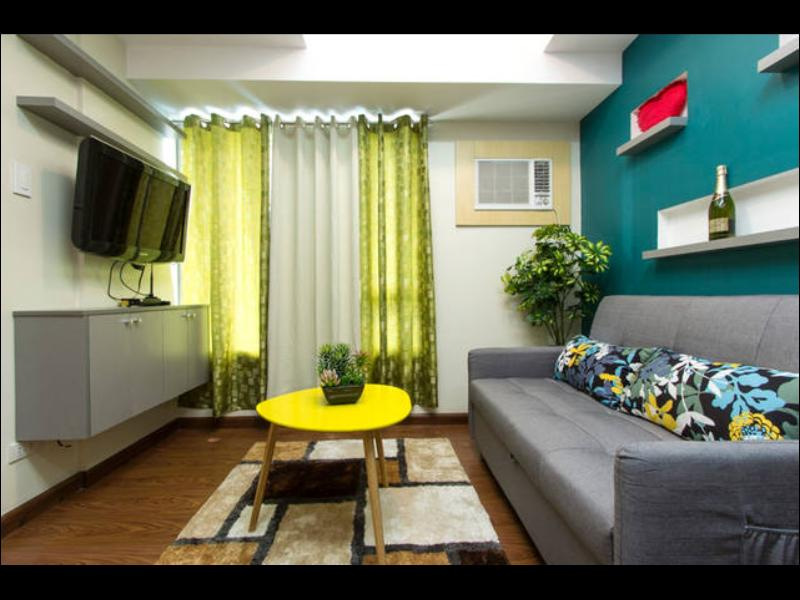 Living Room with 32 inch Samsung LCD TV, ABS-CBN TV Plus, WIFI Internet, SofaBed