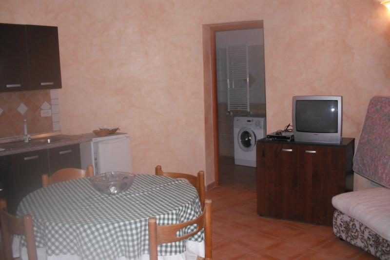 single room with kitchenette and double bed