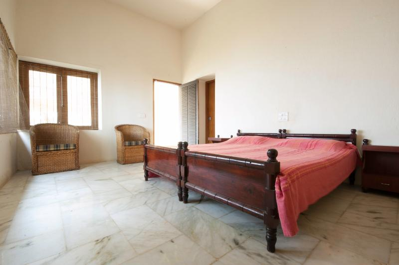 Marble floored bedroom with double bed and en-suite bathroom. Sea views from bedroom and balcony!