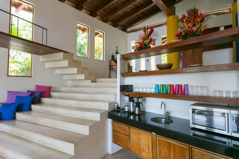 Main Kitchen w/ staircase to Entrance Level and staircase to Mezzanine Level
