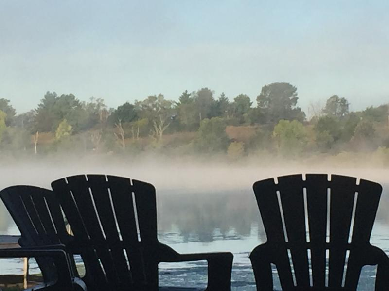 A serene fall morning next to the fire pit overlooking the bay.