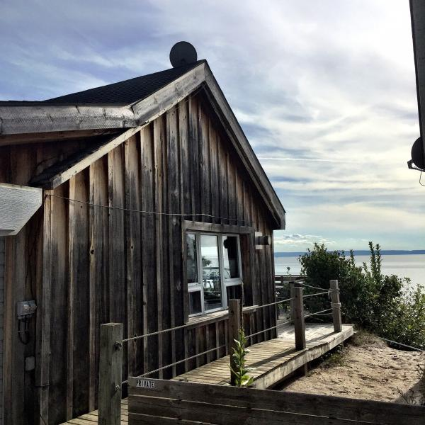 Rustic on the outside, clean and fully renovated on the inside, right on the beach!