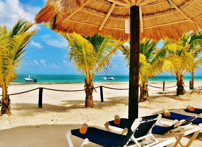 Enjoy the private beach area filled with palapas and lounge chairs right outside your apartment.