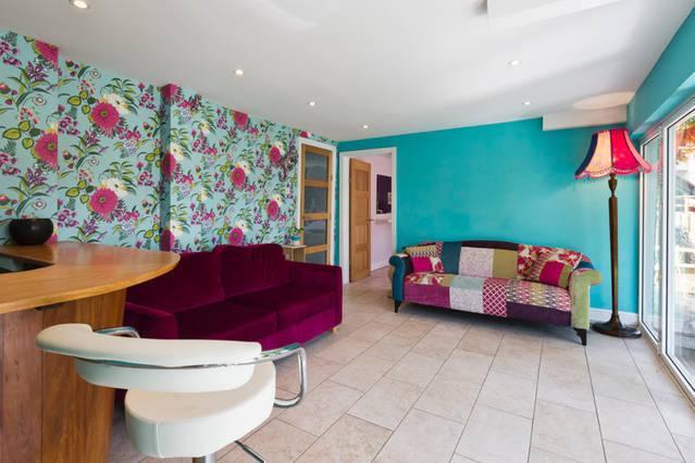 Bar / garden room (lower ground floor) with stunning bifold doors opening directly onto the garden