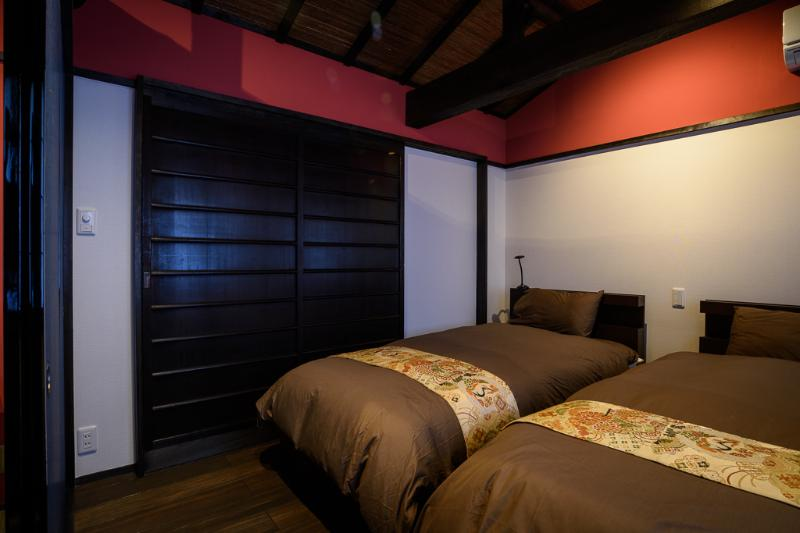 The Western bedroom with two single beds. The wooden sliding doors are closed.