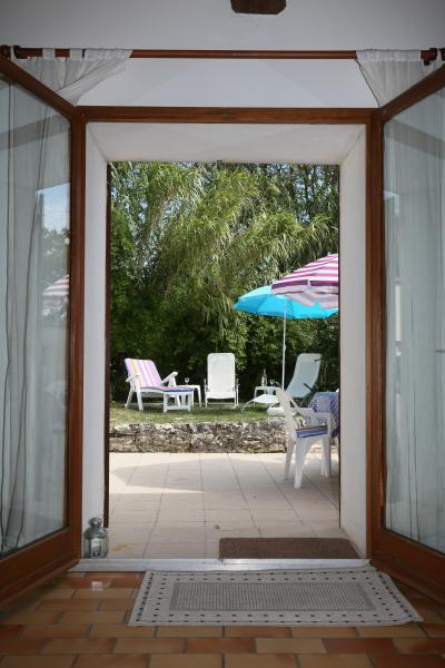 Glass doors open from the sitting room to the rear garden