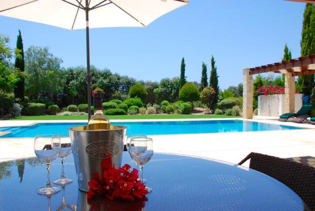Enjoy a bottle of wine by the poolside !