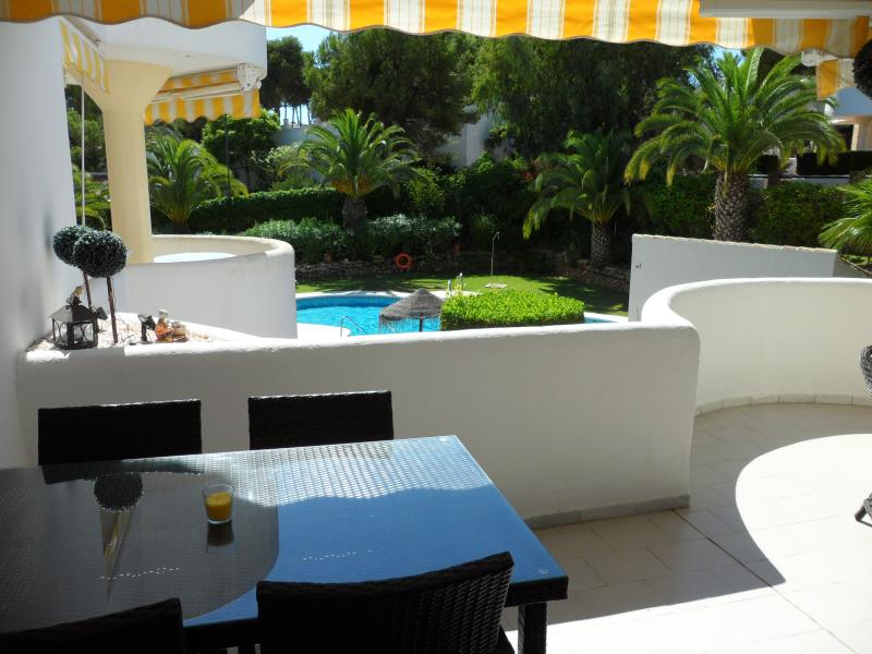 Alfresco dining and lounge area on the large balcony.