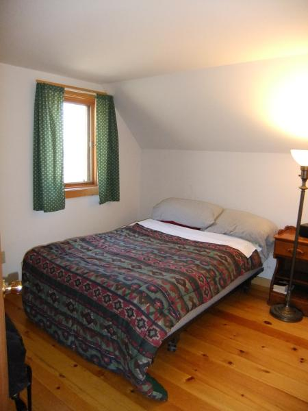 Full-sized bed with North view of the woods.