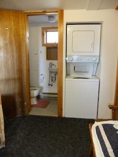 There's a half bath and washer/dryer in the entryway, across from the ground-fl bedroom.