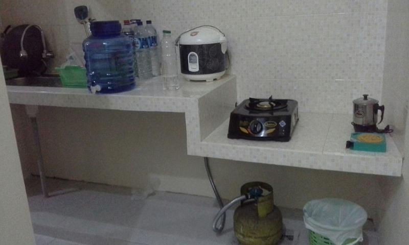 Kitchen with appliances in Puncak Garuda villa