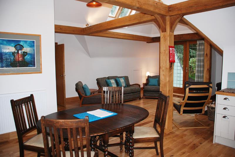 Open plan lounge with oak posts and beams