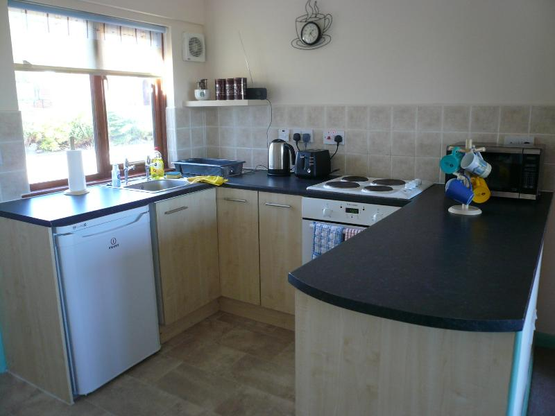 kitchen area with all mod cons