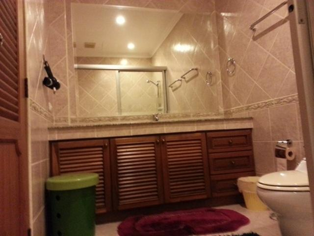 Big mirror, hairdryer, hand wash with cold and hot water and cupboards and drawers below