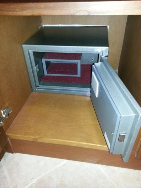 View on private electronic safe, you may change the combination. Safe fixed on concrete floor