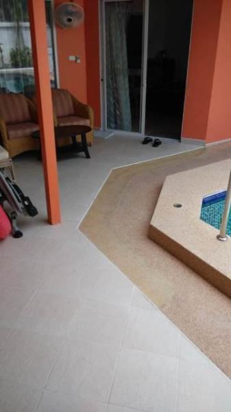 Sand washed stone ramps for wheelchair users, leading down to the swimming-pool and up to guestroom