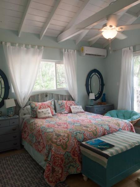 Master bedroom 1 - 'Star' themed with papasan chair overlooking emerald sea