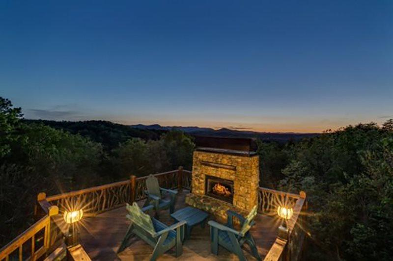 Twilight in the Mountains around this Outdoor Fireplace