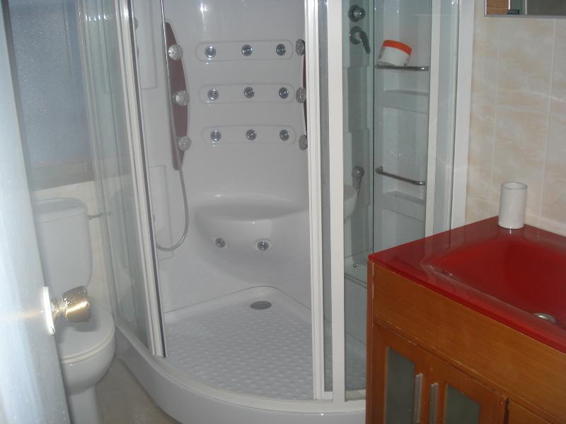 Bathroom with hydromassage shower cabin