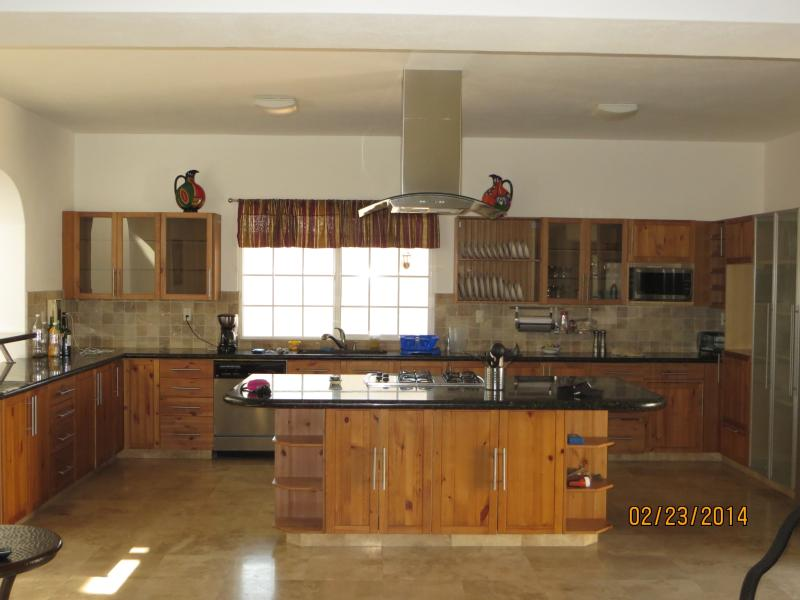 Large fully equipped open kitchen with bar seating that is great for entertaining