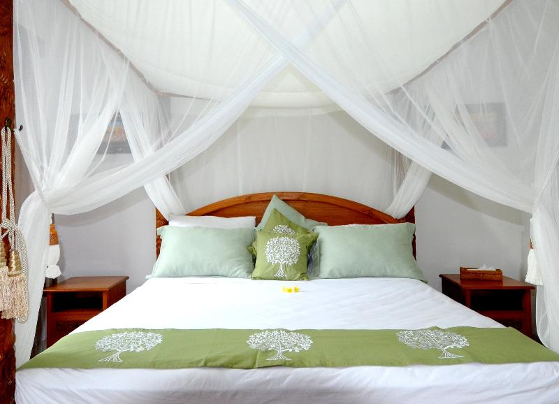 superior room, teak carved king size 180x200cm bed come with out door shower. garden out the window
