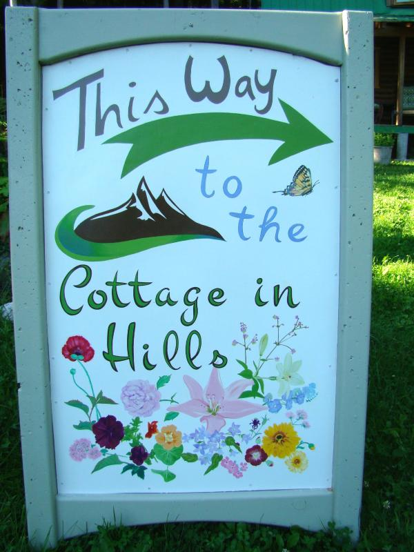 Our sign... this way to The Cottage in Hills