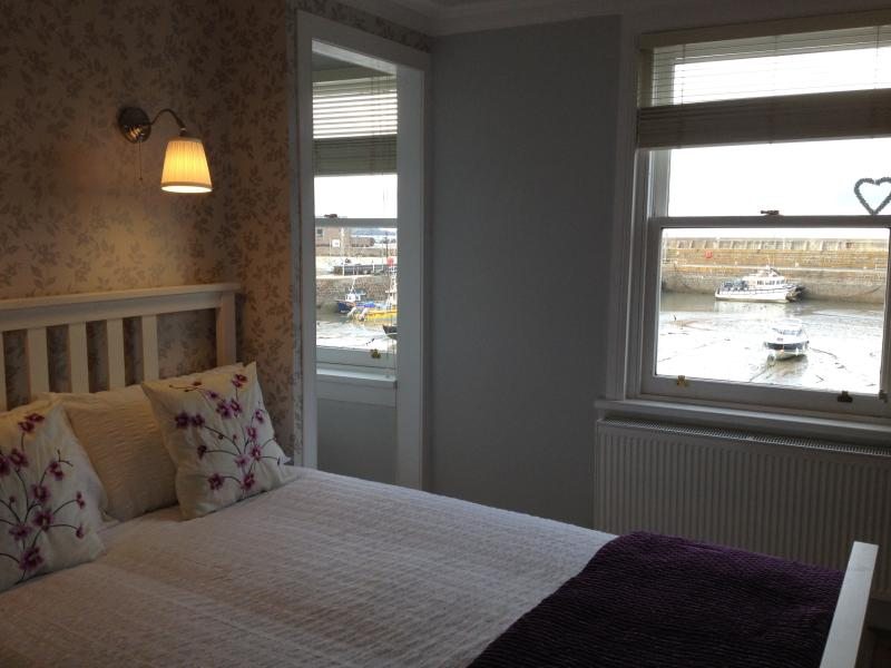 Beautifully decorated 1st floor double bedroom with sea views
