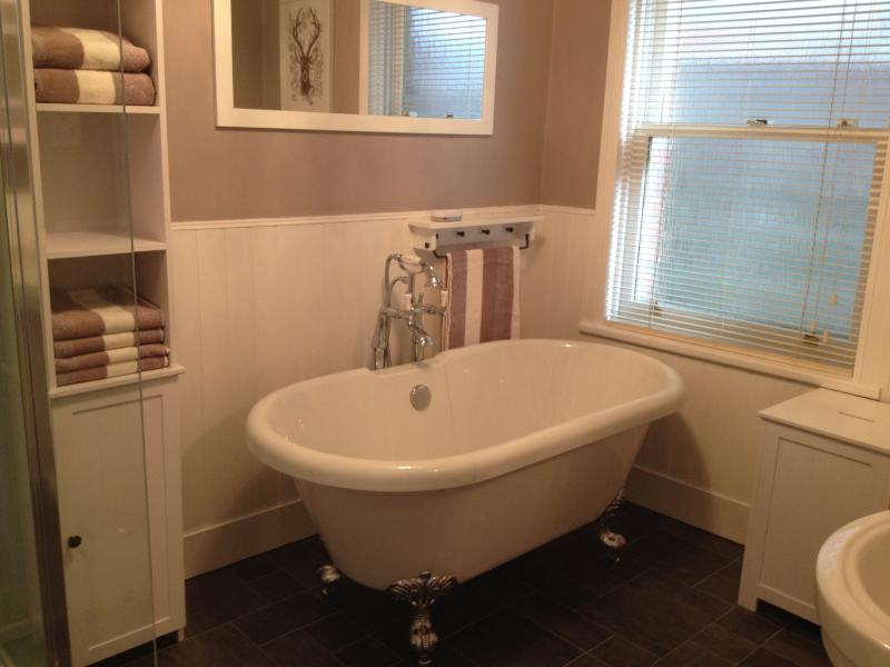 Stylish bathroom with roll-top bath and separate shower