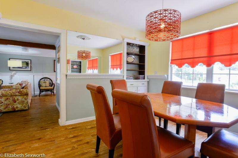 Separate dining room with table seats 6-8