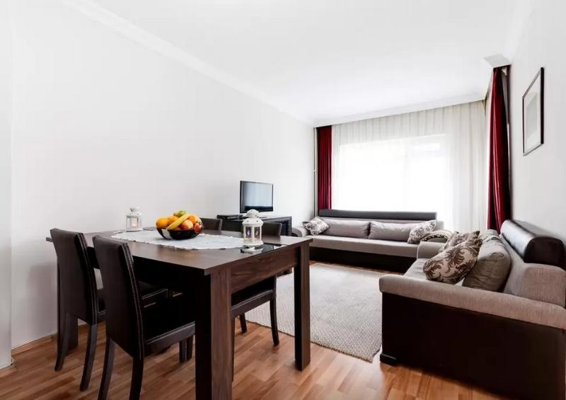 Living room; sofas, full HD cableTV and dining table for six.
