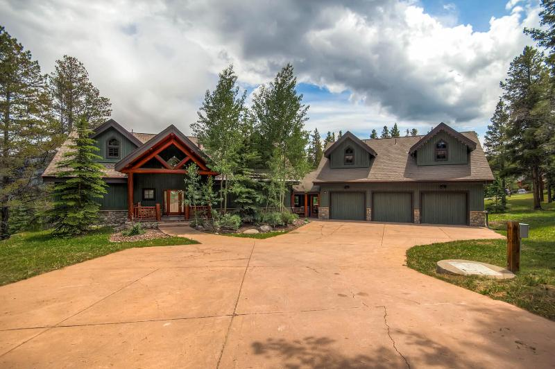 Front entrance with plenty of parking and well maintained three car garage