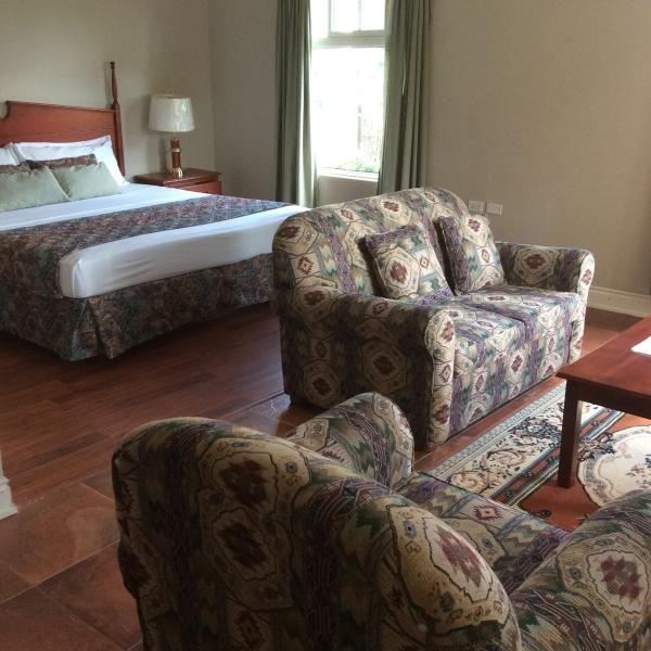 Luxury Standard room, with King-bed, 2-seater Jacuzzi, sitting area, mini-fridge & microwave