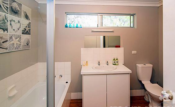 Private, modern, inviting bathroom