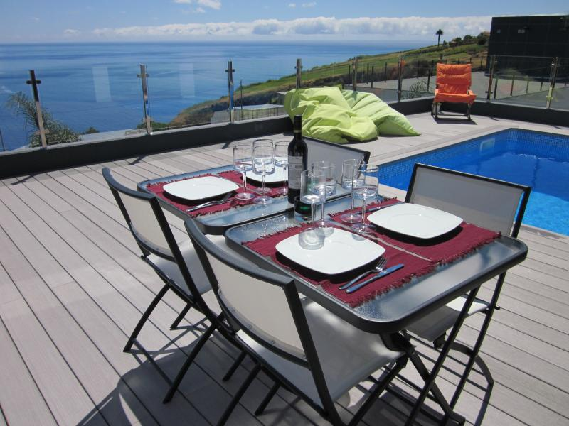 Dinning on the sun-deck with sea views.