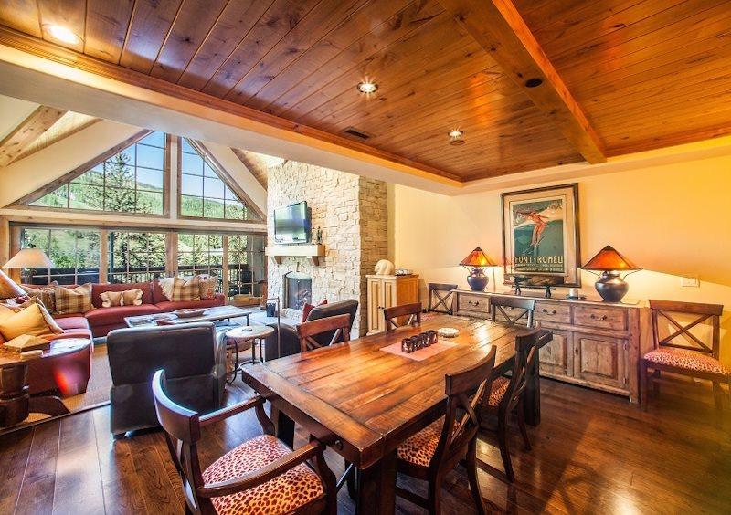Open living area with stone fireplace and flat screen TV