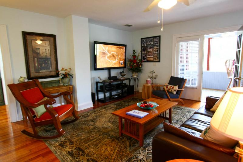 Relax in this spacious living with a large flat screen TV.