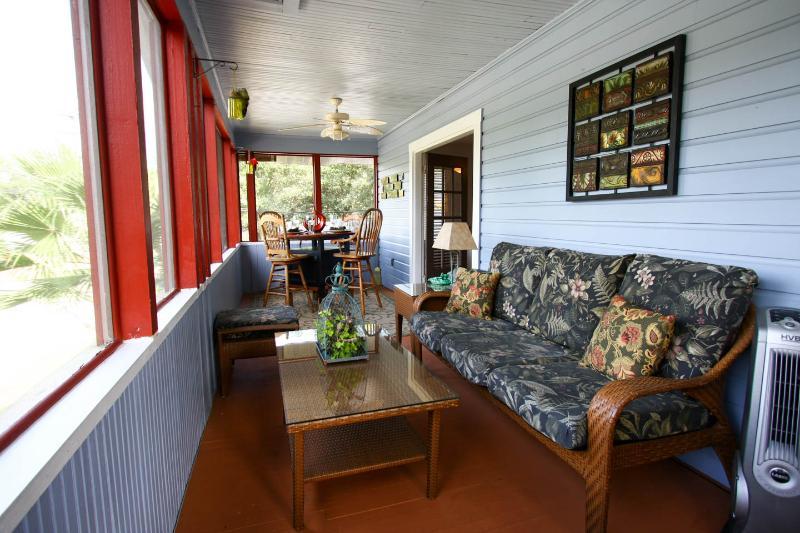 Screened Veranda seating area.