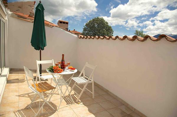 Sunny terrace with views across Mount Canigou