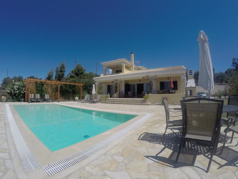 Villa Theia. An award winning villa with the most amazing sea and sunset views.