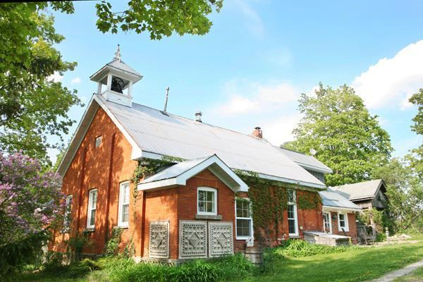 Century Old School House Surrounded by Luscious Green Grounds