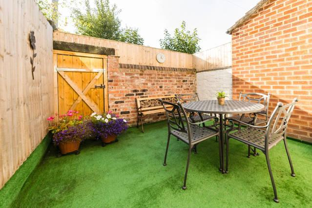 Private Walled Courtyard, seating area with seasonal flowers,to relax and enjoy glass of Vino.