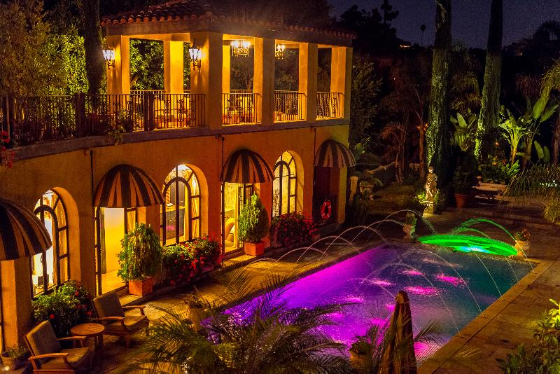 The Villa Sophia guesthouse rental has private pool with night time lighting and classical fountain.