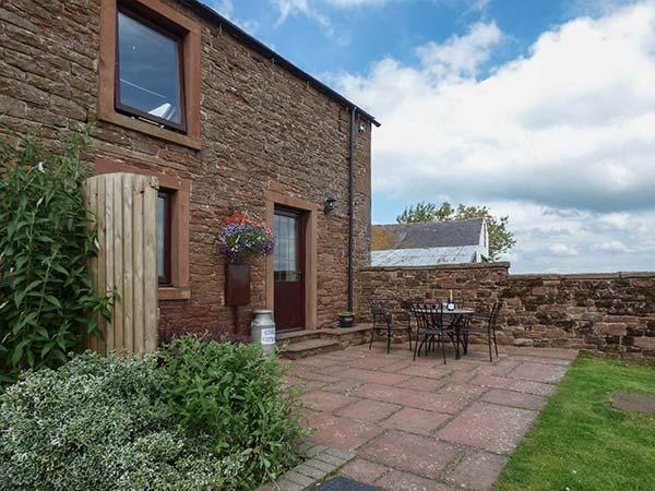 STABLE COTTAGE, owner's farm, woodburner, WiFi, ample parking, private patio, holiday rental in Boltongate