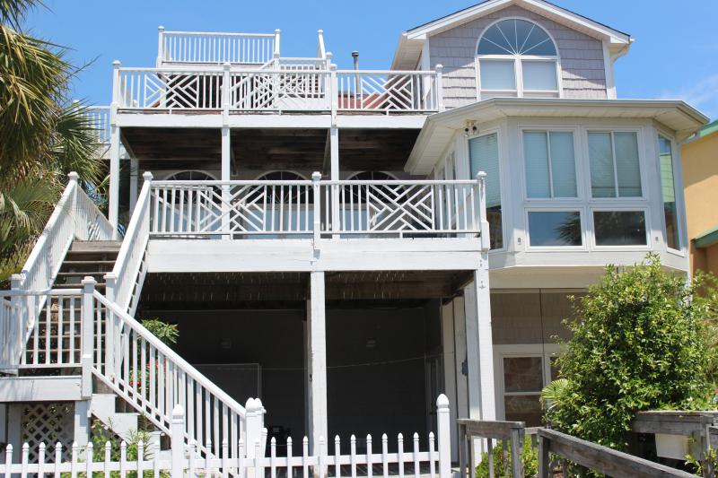 View of the waterside of house, 3 level decking from ground level.