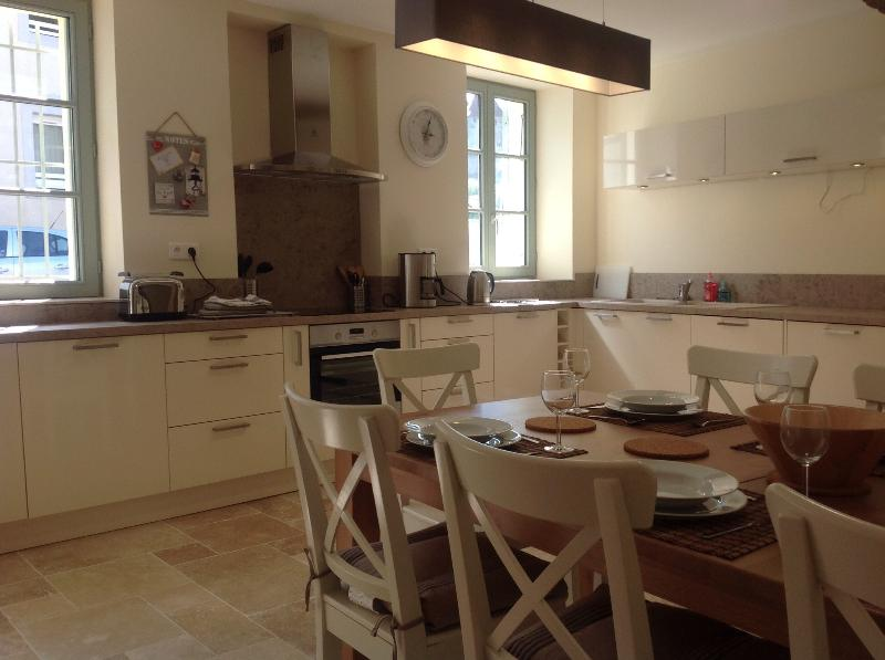 Fully fitted kitchen with large dining table for eight persons.